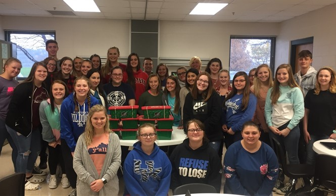 HOSA students pack shoe boxes for Operation Christmas Child.