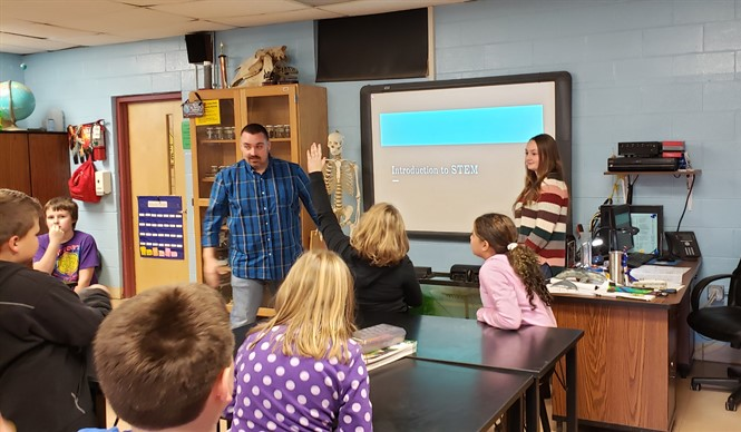 UK student Haley Dicken talks with 4th graders about careers in STEM fields.