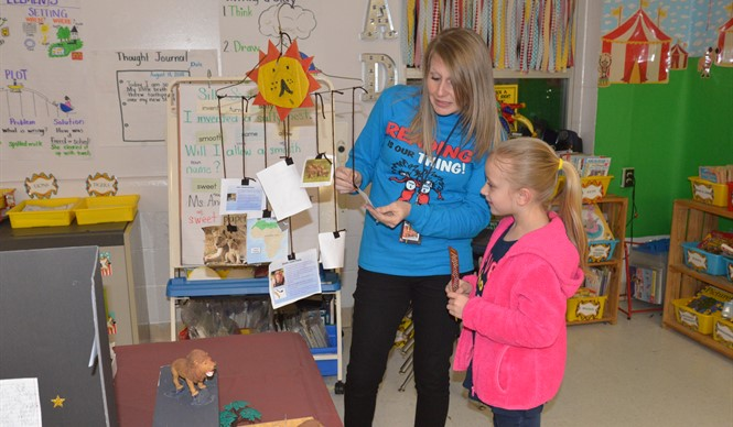 AES was transformed into a museum for Family Literacy Night, with each grade level featuring exhibits, student work displays, and literacy activities.