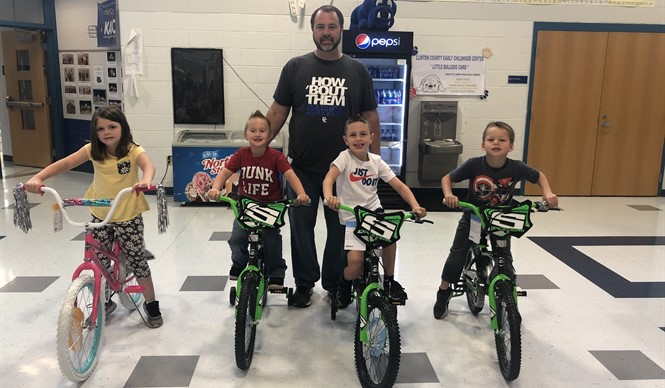 Calirose Johnson, Carson Wells, Bentley Creekmore, & Knoxx Duvall received new bikes for having perfect attendance at ECC.