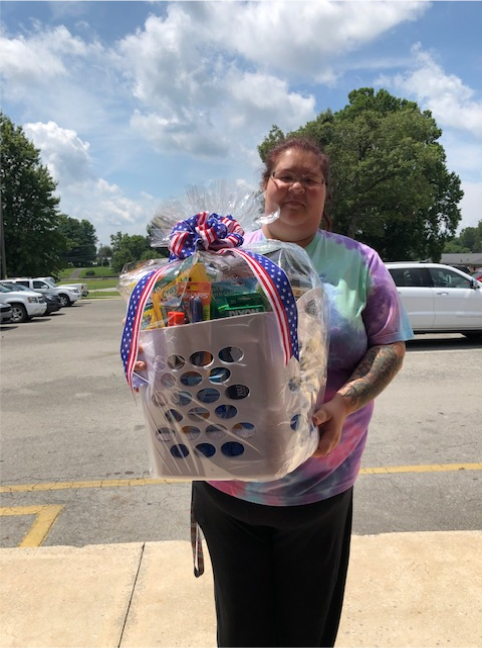 Ashley Starns was the winner of the gift basket drawing for parents of students in 3rd & 4th grade at AES.