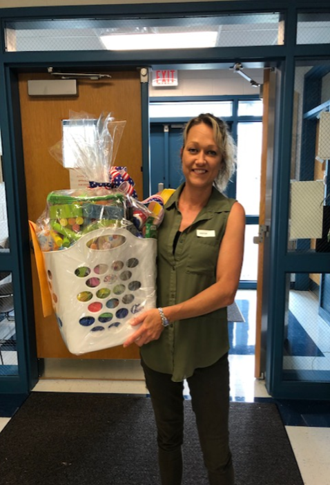 StacyShelley was the winner of the gift basket drawing for parents of students in kindergarten at ECC.