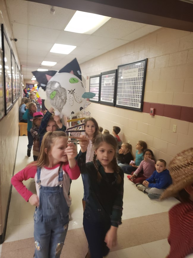Students created their own character balloons and designed a way to handle the balloons in the 2019 AES Thanksgiving Parade.