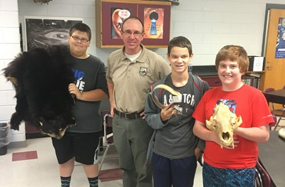 Chris Mason, Private Land Biologist for the Kentucky Department of Fish and Wildlife, was guest speaker in Mr. Michial Conner's 8th grade science classes at CCMS.