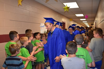 On Tuesday, May 15, 2018 - the last day of school - the Clinton County High School graduating class visited the Albany Elementary School for their Senior Walk.
