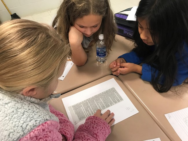 Students in Mr. Robert McDaniel's 4th grade class at AES are using articles from Clinton County News to learn about main idea.
