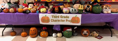 Students in Ms. Mindie Anderson's and Mrs. Samantha Blackaby's 3rd grade classes at AES completed a Pumpkin Character Book Report.