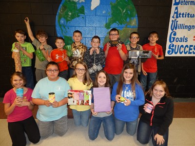 Students in Mrs. Lora Grant's third 9-weeks 5th, 6th, 7th, and 8th grade practical living & career studies classes at CCMS are pictured here with their RRR projects.