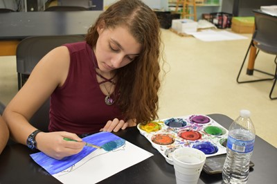 During the Showcasing the Arts program at CCHS, students used their own creativity and imagination to finish an incomplete landscape created using only basic shapes and lines.