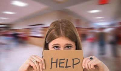 "Student with ""Help"" sign"