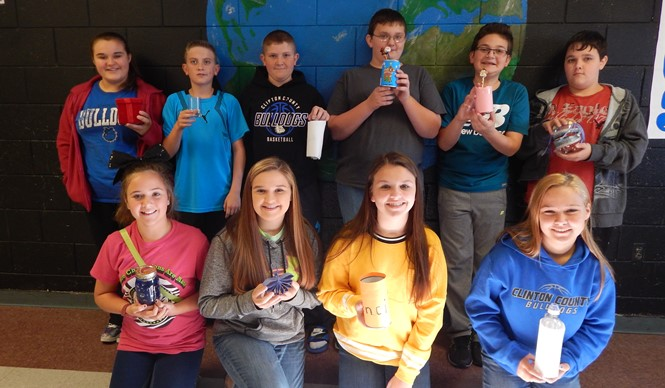 CCMS students show off their Reduce, Reuse, Recycle projects.
