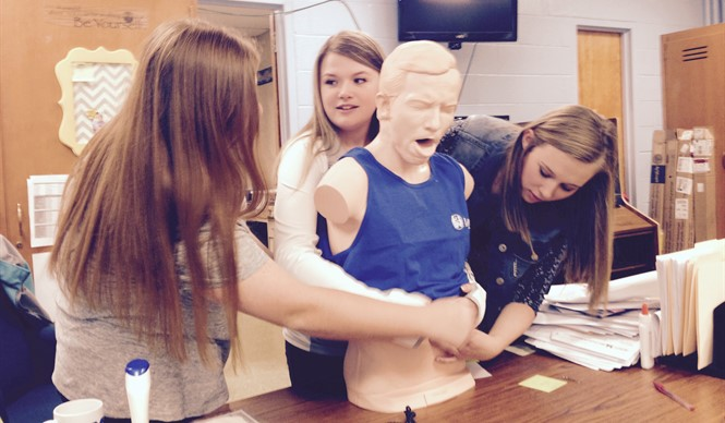 Students learn CPR and first aid techniques with new manikins at CCHS.