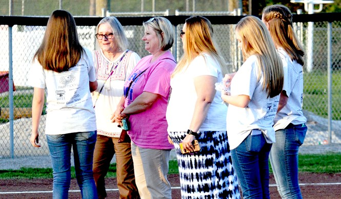 CCHS Relay for Life team and softball team honors cancer survivors at Pink Out night.