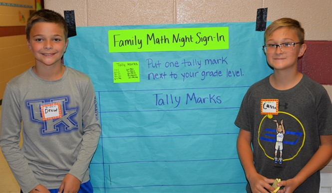Fourth grade students help out during Family Math Night at AES.