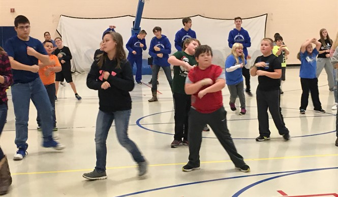 Healthy Hometown Fitness Buddies exercise together.