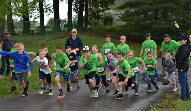 It was a rainy Run for the Roses at the 5th annual Healthy Hometown 1K Family Fun Run & 5K.