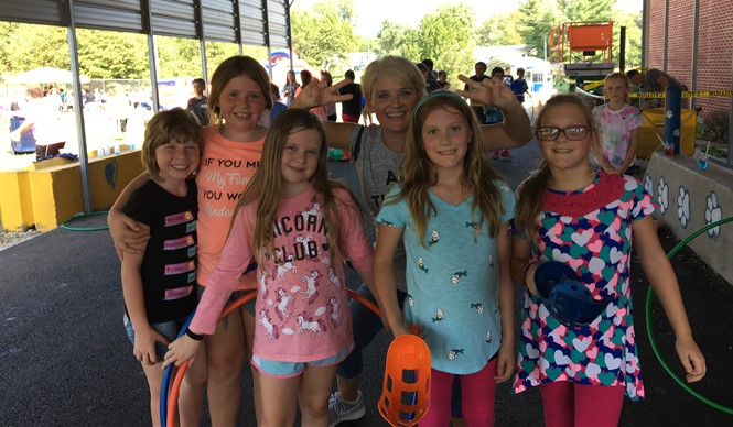 Students at Albany Elementary School celebrated High Attendance Day with inflatables, slushies, games, and prizes!