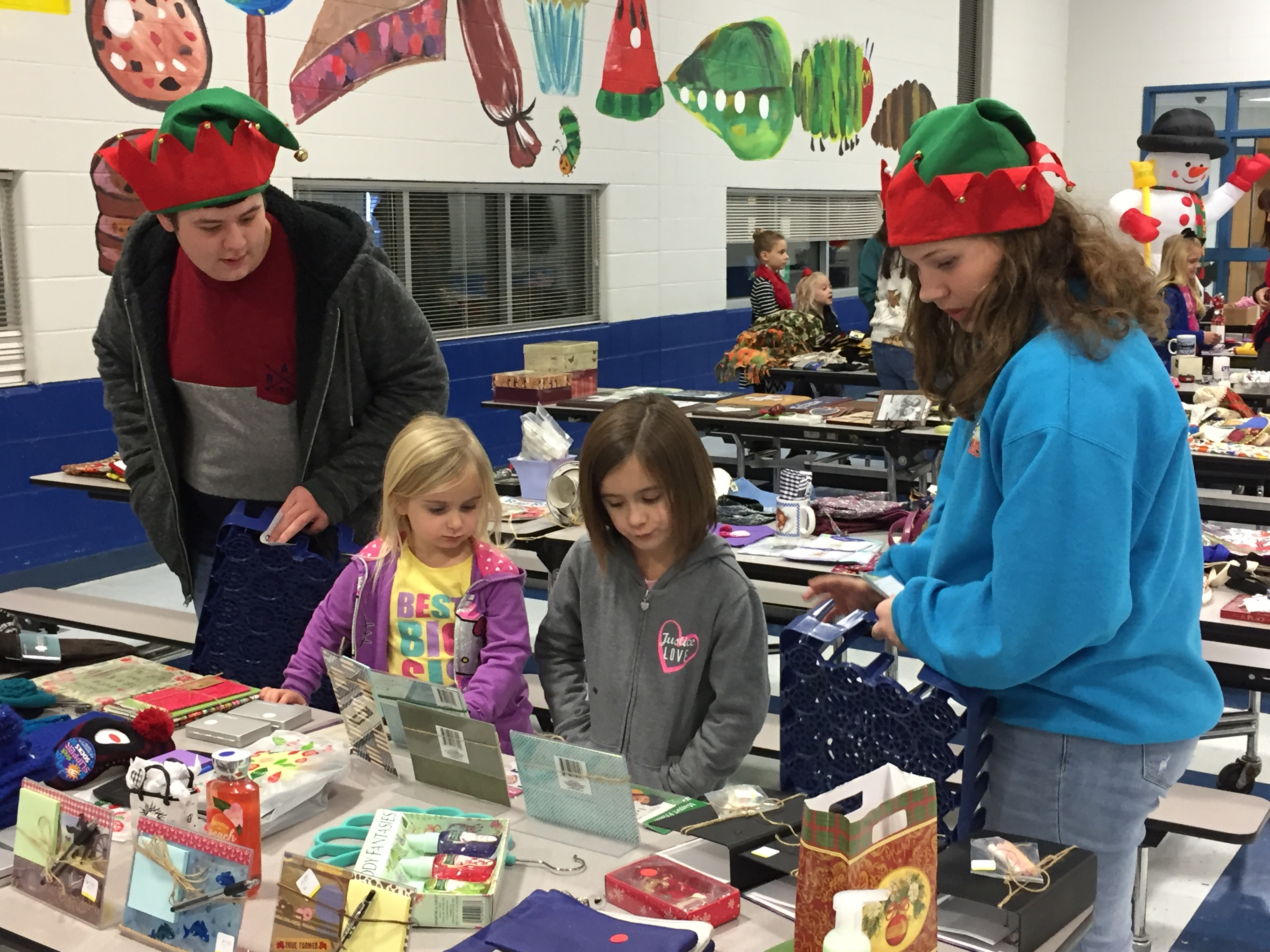 FBLA student volunteers help out with the annual Christmas Village.