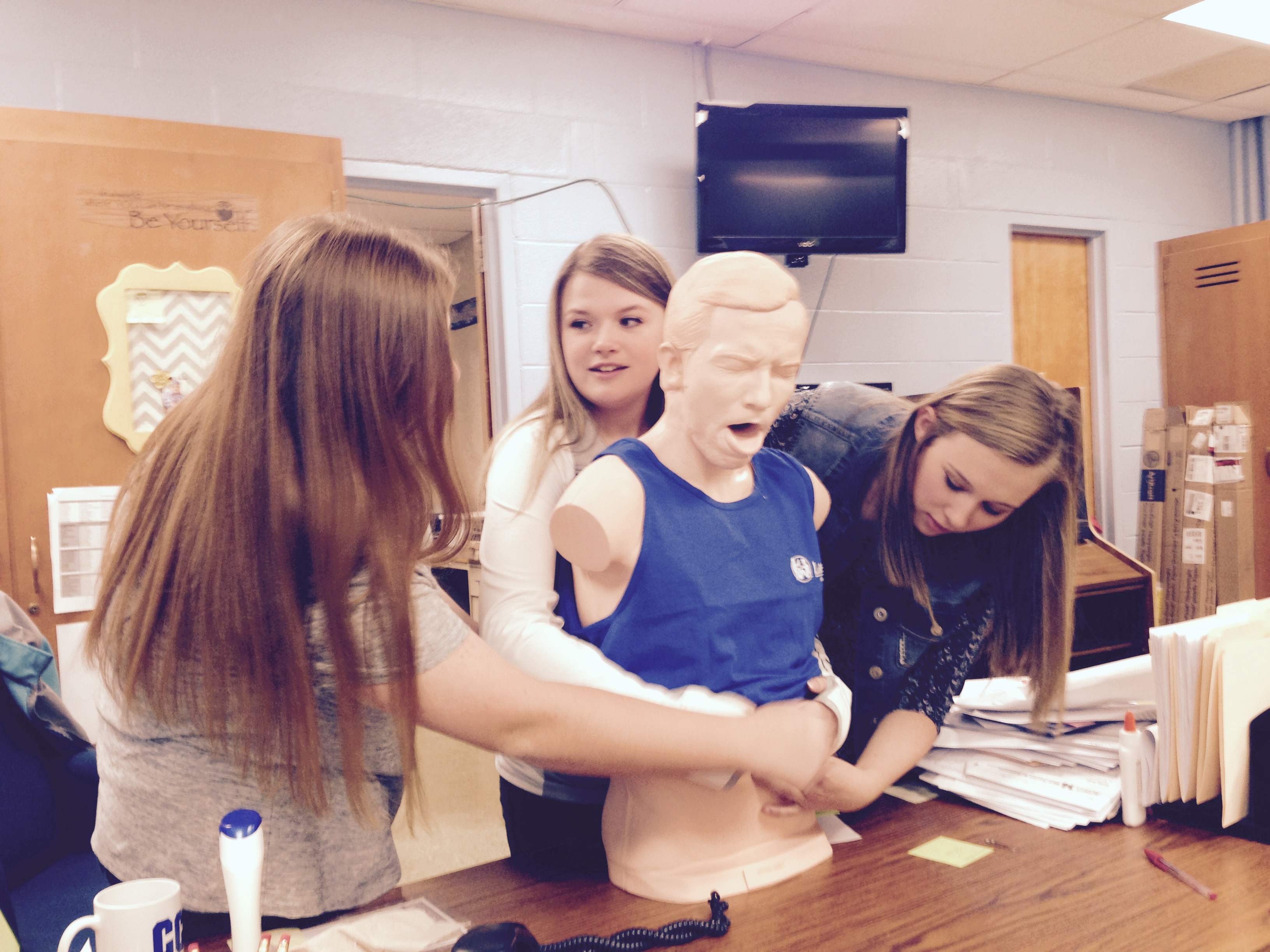 Students in Mrs. Kathy Hunter's and Mrs. Tyonia Sinclair's health classes at Clinton County High School are learning CPR basics.