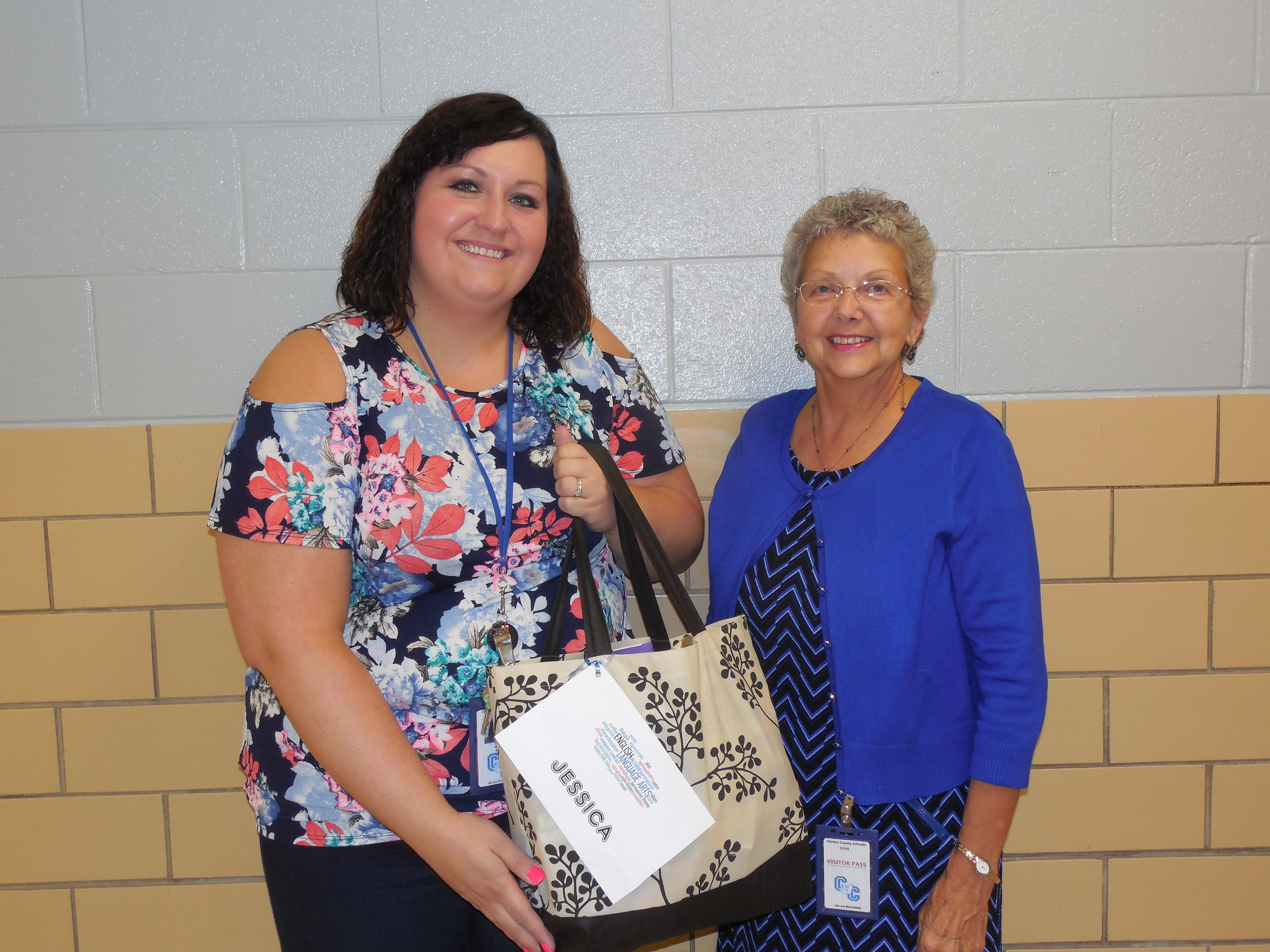 Jessica Ndiaye, English teacher at CCHS, receives her gift from Mrs. Stearns.