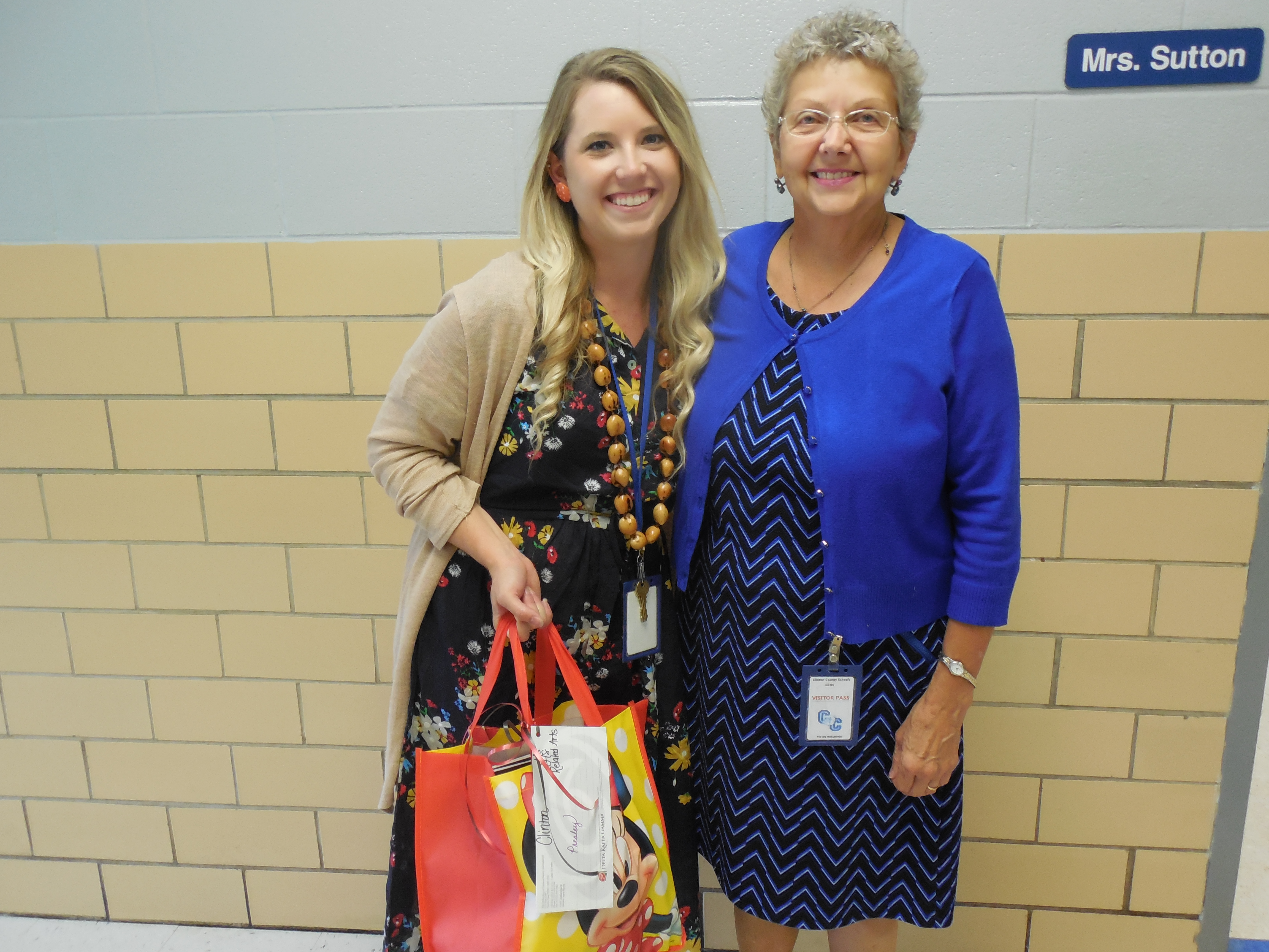 Presley Sutton, art teacher at CCMS & CCHS, receives her gift from Mrs. Stearns.
