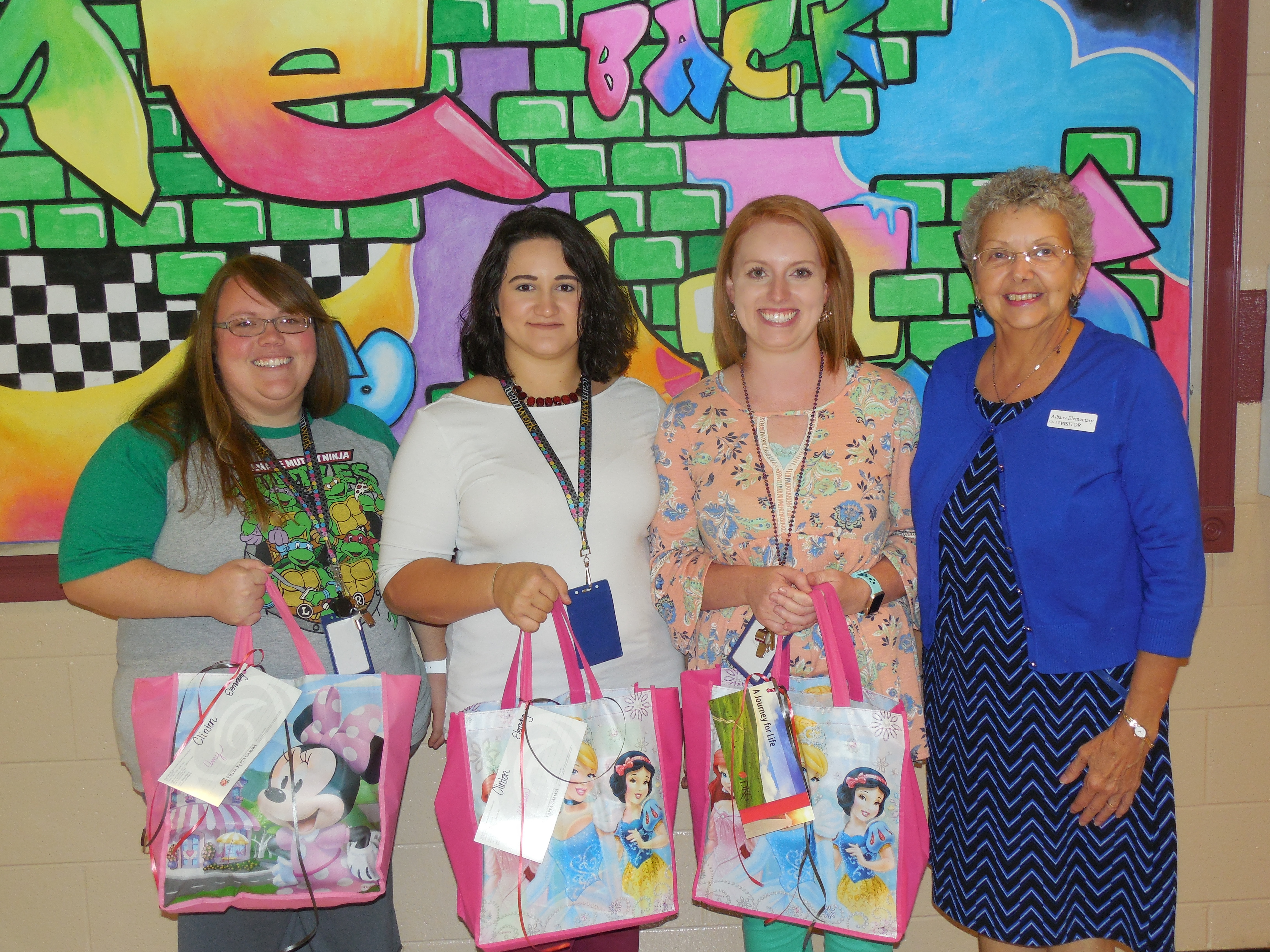 Amy Norris & Allison Jarvis, 4th grade teachers at AES, and Mindie Anderson, 3rd grade teacher at AES, receive their gifts from Mrs. Stearns.