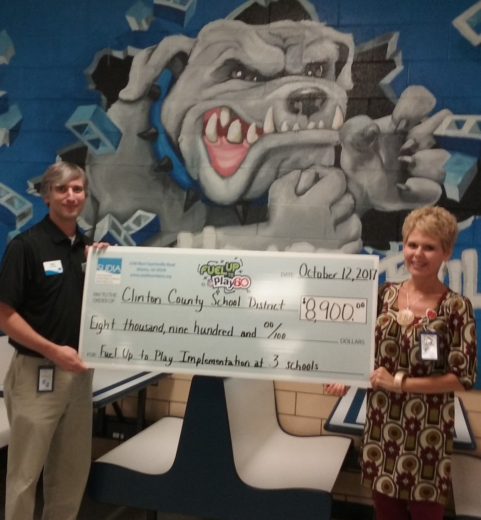 Clinton County Schools Food Service Director Paulette Brinley is pictured here with Alan Curtsinger of the Southeast United Dairy Association accepting a check in the amount of $8,900.00 from Fuel Up to Play 60.