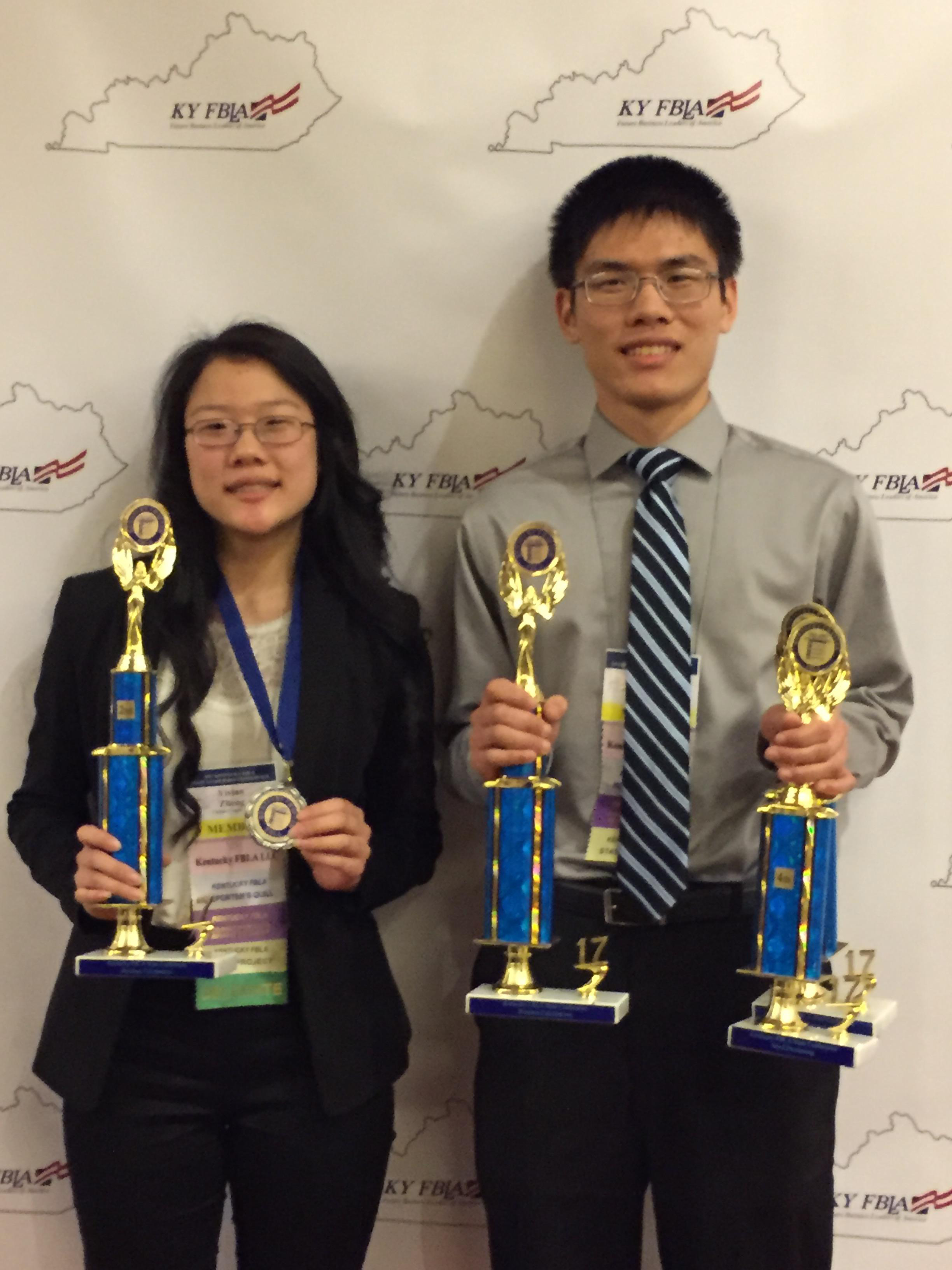 Pictured above are Vivian Zheng and Frank Zheng with their awards from the FBLA State Leadership Conference.
