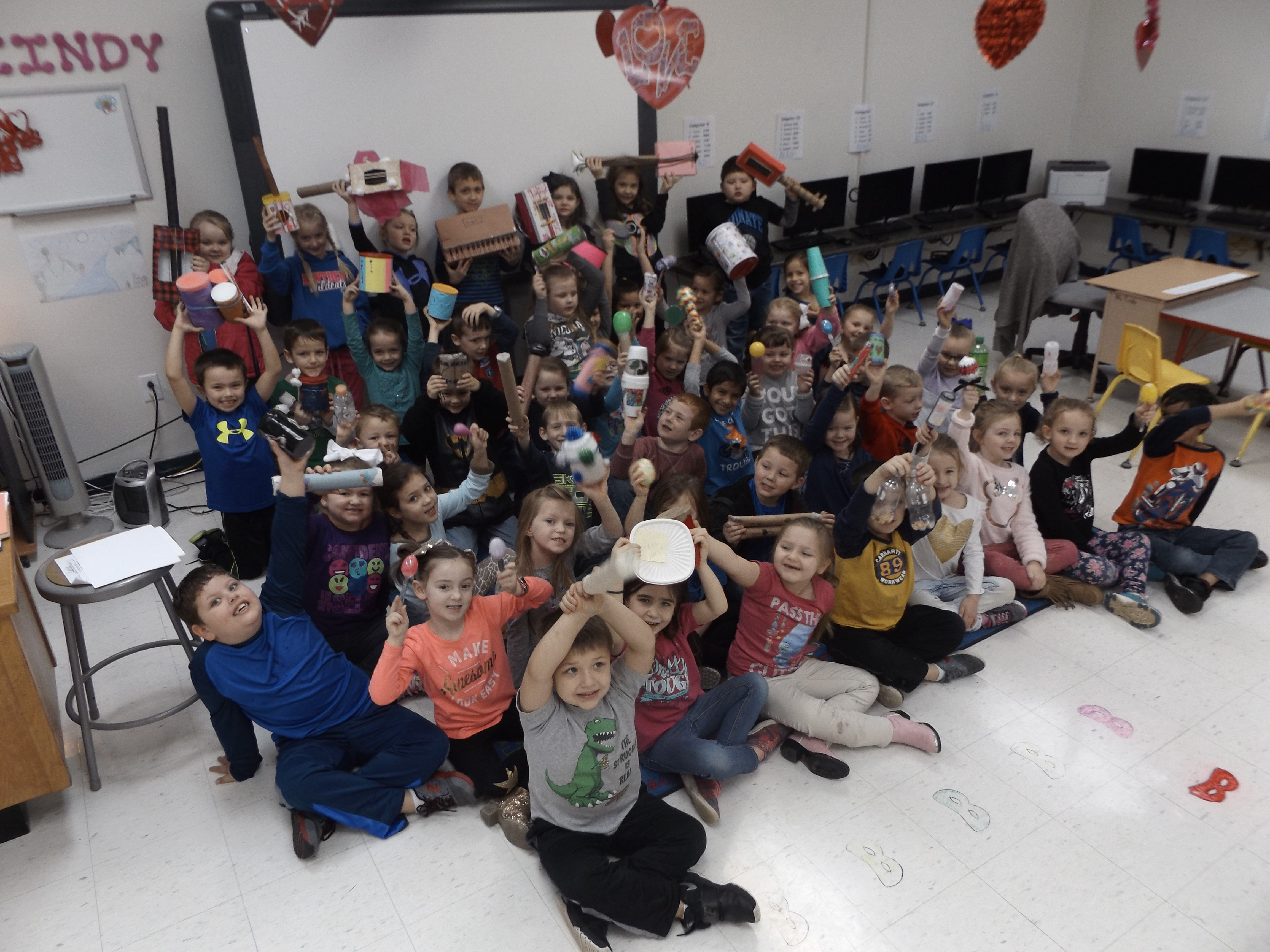 Kindergarten students in Mrs. Cindy Wallace's related arts classes at the Clinton County Early Childhood Center show off some of their Cyber Day work - homemade musical instruments!