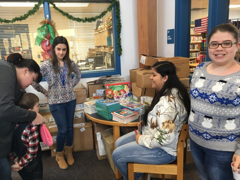 FBLA students help out at the Christmas Program at the Public Library.