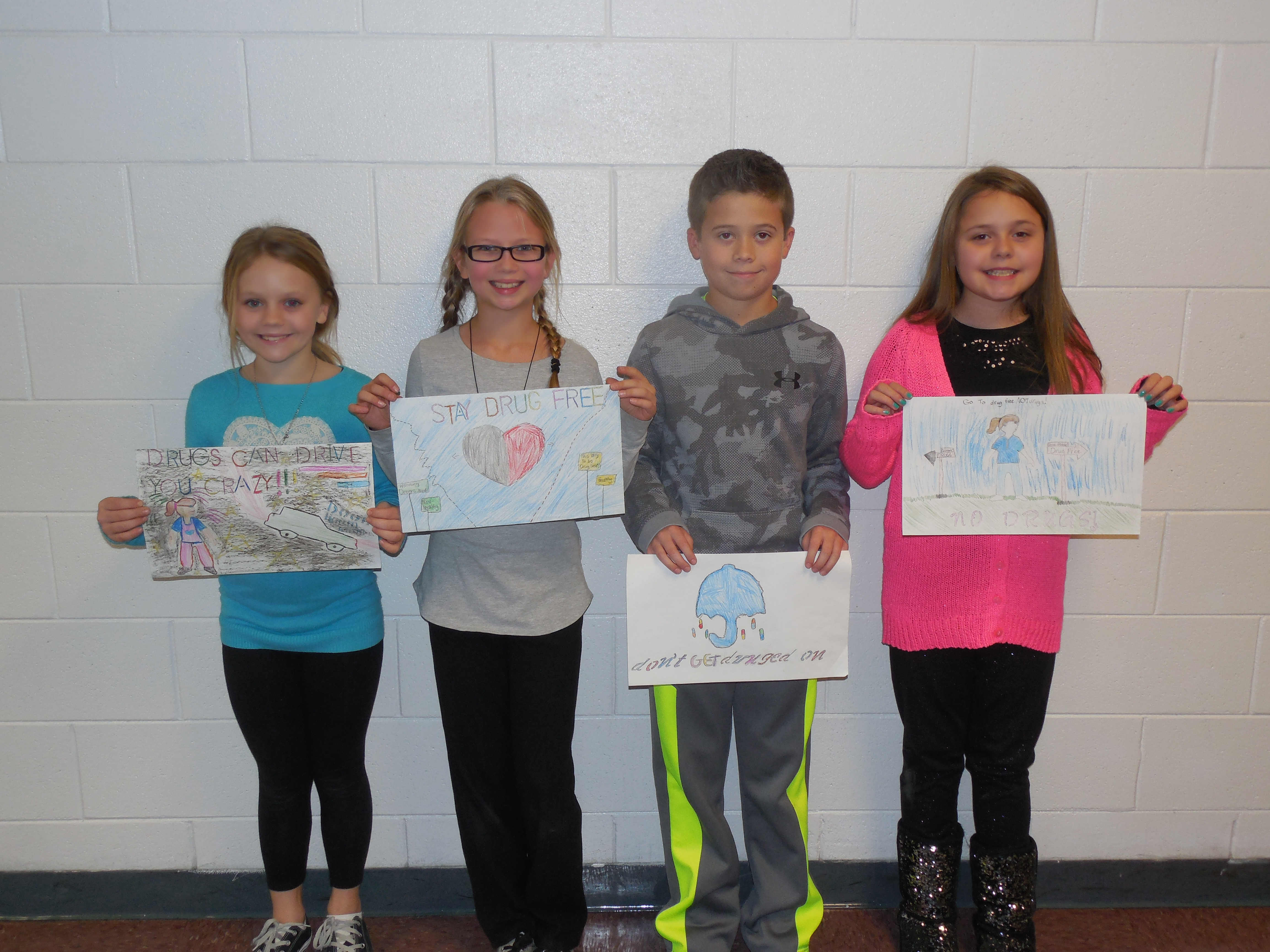 5th grade poster contest winners:  Saylor Burchett (1st place), Akira Nagel (2nd place), Cameron Harmon (tie—3rd place), and Maddie McFall (tie—3rd place).