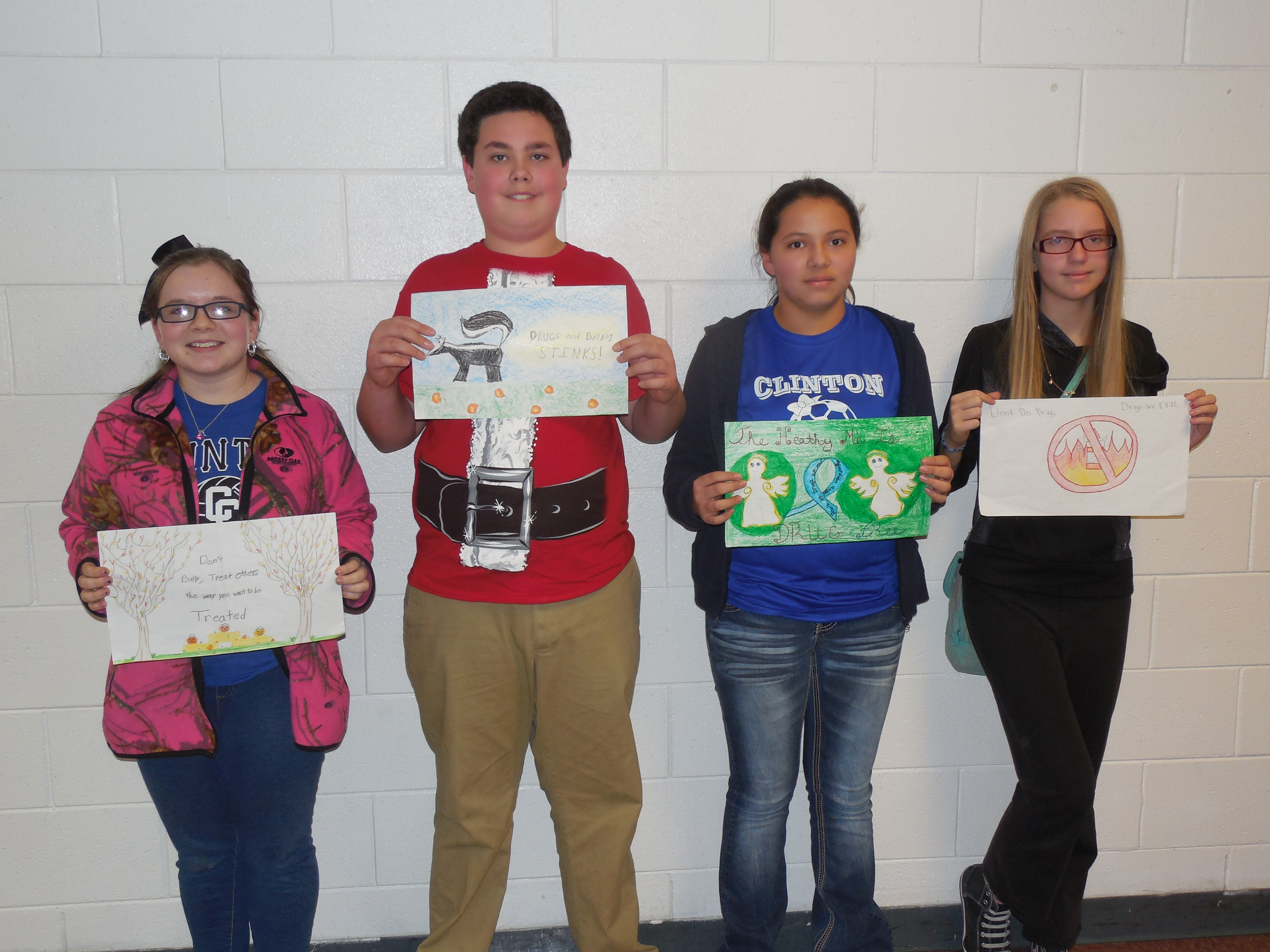 6th grade poster contest winners:  Megan Neal (1st place), Alex Duvall (2nd place), Stacy Pascual (tie—3rd place), and Jillian Perdue (tie—3rd place).