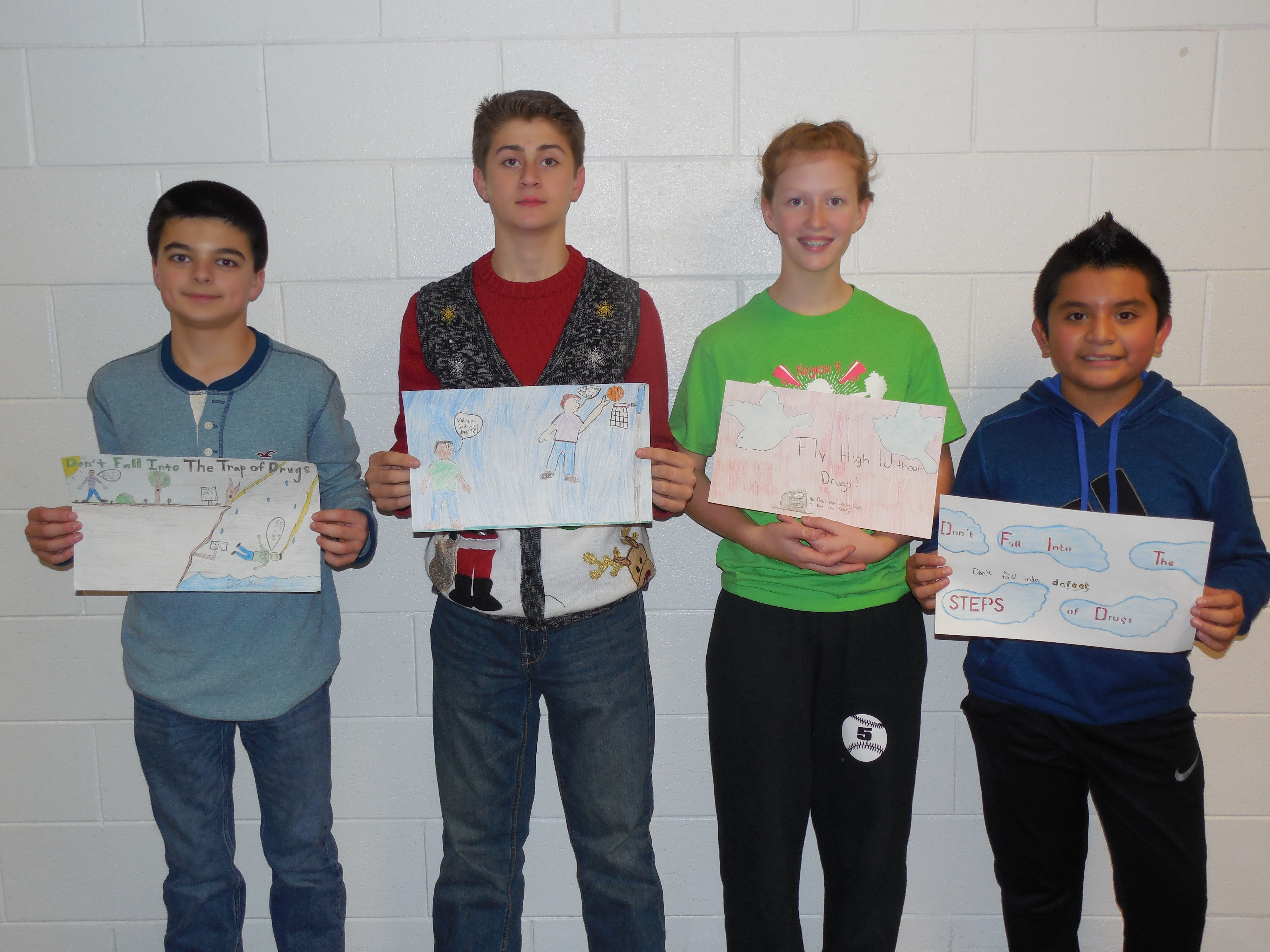 7th grade poster contest winners:  Ben Tallent (1st place), Christian Derryberry (2nd place), Delaney Chilton (tie—3rd place), and Jimmy Mazariegos (tie—3rd place).