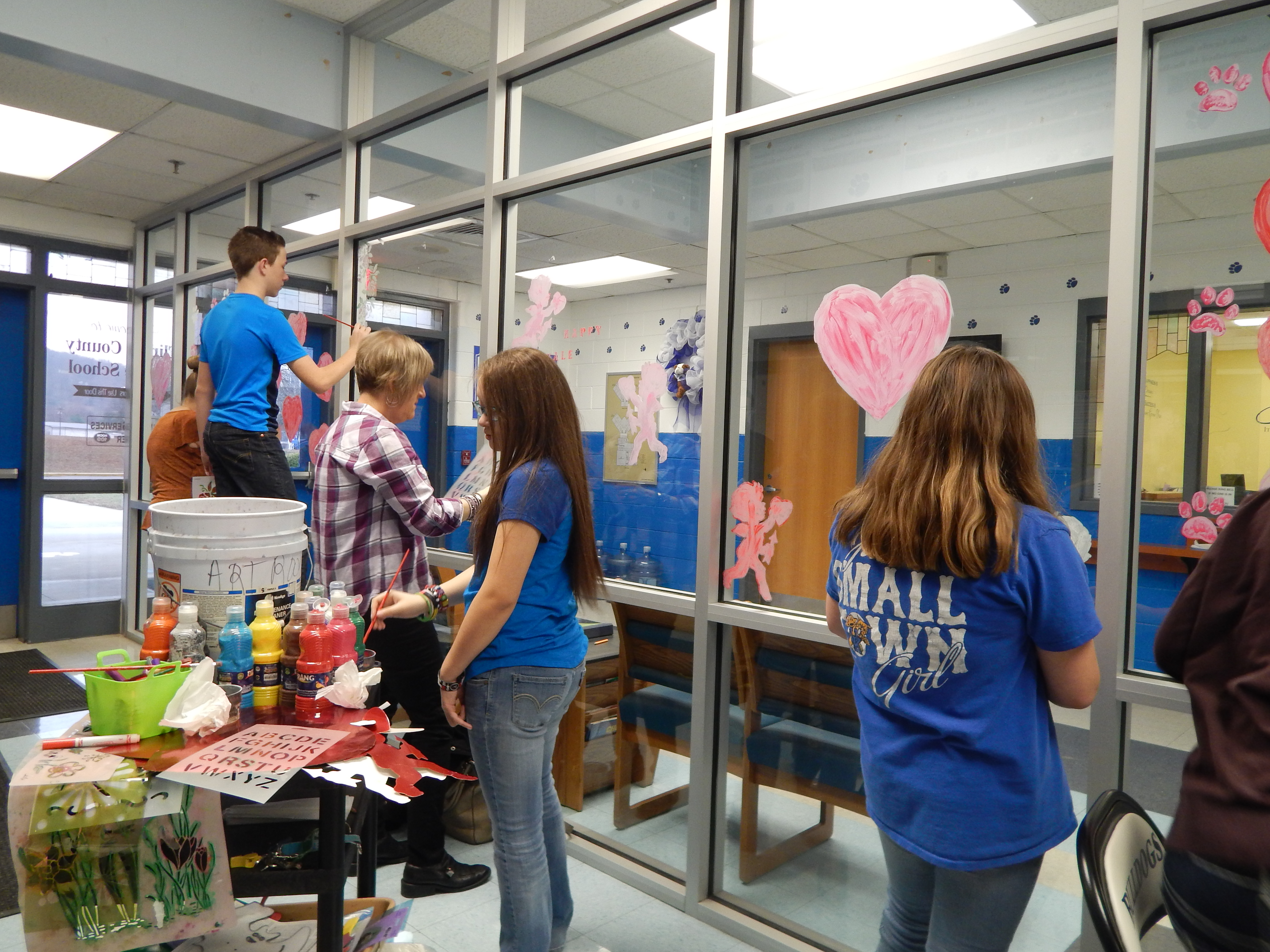 The 8th grade students in Mrs. Pam Miniard's art classes at CCMS put their painting skills to work and decorated the lobby for Valentine's Day.